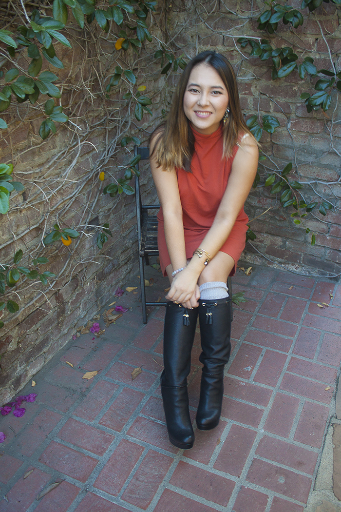 teen in high boots